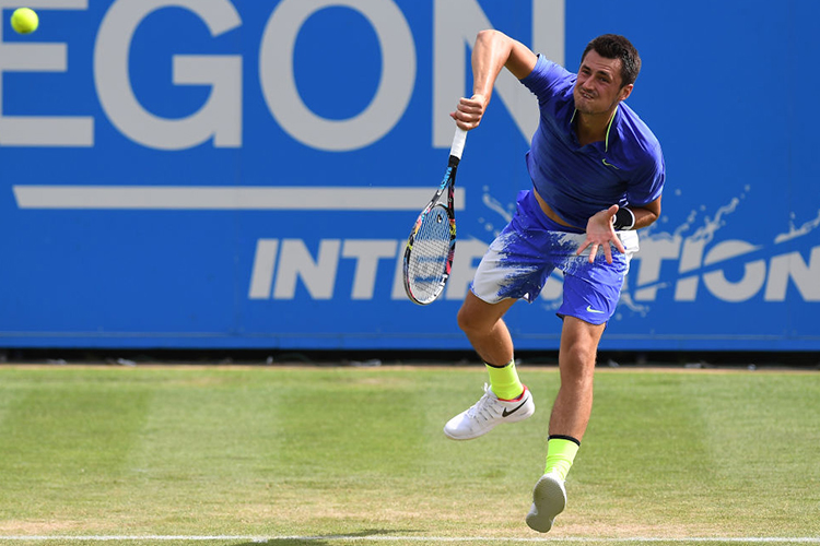 BERNARD TOMIC of Australia serves during the men's singles quarter final match of the Aegon International Eastbourne at Devonshire Park Lawn Tennis Club in Eastbourne, England.