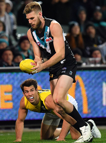 Jackson Trengove of the Power evades a tackle and runs to kick a goal during their round 15 AFL clash against Richmond. July 1, 2017
