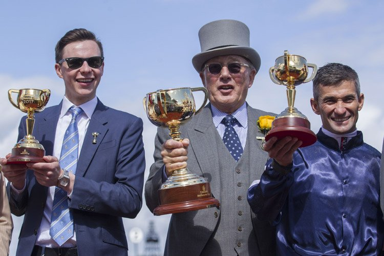 Trainer Joseph O'Brien, Owner LLoyd Williams and Jockey Corey Brown after Rekindling winning the Emirates Melbourne Cup.