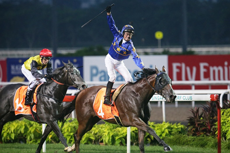 Glen Boss raises his arm in delight as Lim's Cruiser comes out tops in the Lion City Cup.