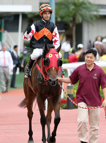 Joao Moreira completes his four-timer aboard the Dennis Yip-trained Winning Controller.