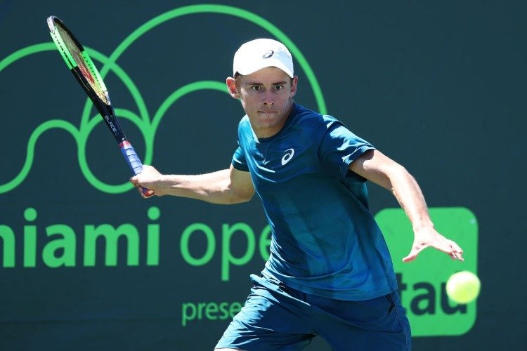 ALEX DE MINAUR of Australia plays a shot against Yoshihito Nishioka of Japan during Miami Open at the Crandon Park Tennis Center in Key Biscayne, Florida.