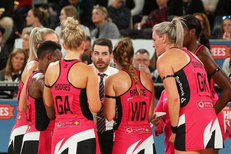Thunderbirds Head Coach with players.