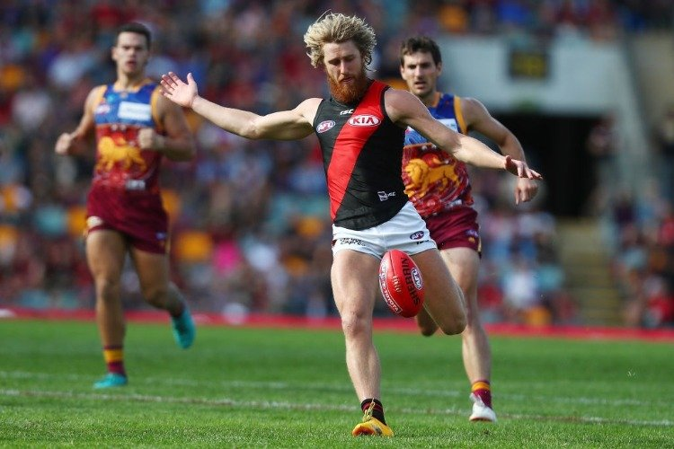 DYSON HEPPELL leads the Bombers kicks during the AFL match between the Brisbane Lions and the Essendon Bombers at The Gabba in Brisbane, Australia.