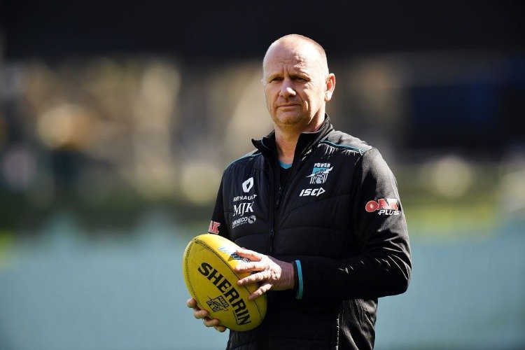 KEN HINKLEY the coach of the Power looks on during a Port Adelaide Power AFL training session at Adelaide Oval in Adelaide, Australia.