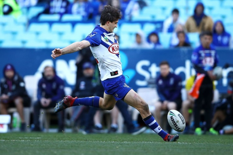LACHLAN LEWIS of the Bulldogs kicks the match winning field goal during the NRL match between the Canterbury Bulldogs and the New Zealand Warriors at ANZ Stadium in Sydney, Australia.