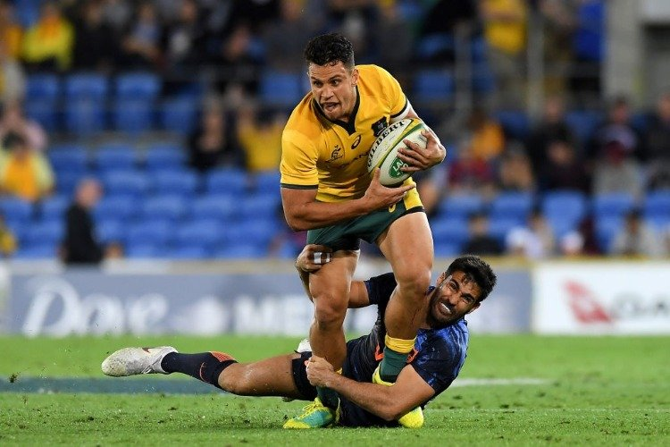 MATT TOOMUA of the Wallabies is tackled during The Rugby Championship match between the Australian Wallabies and Argentina Pumas at Cbus Super Stadium in Gold Coast, Australia.