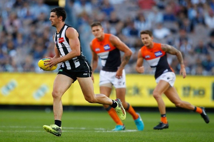 SCOTT PENDLEBURY of the Magpies runs with the ball during the AFL match between the Collingwood Magpies and the Greater Western Sydney Giants at MCG in Melbourne, Australia.