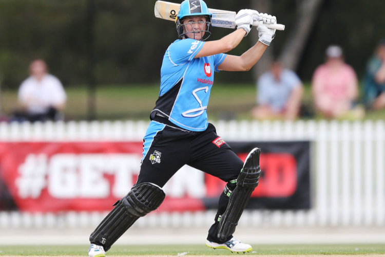 SOPHIE DEVINE of the Strikers bats during the Women's Big Bash League match between the Melbourne Renegades and the Adelaide Strikers at CitiPower Centre in Melbourne, Australia.