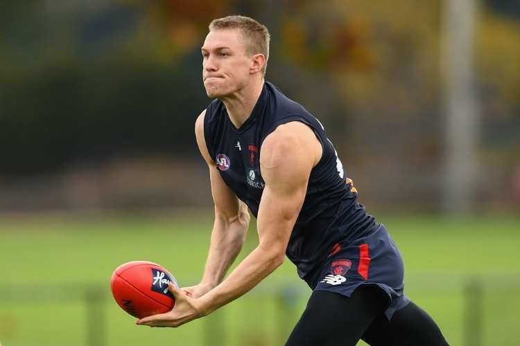 TOM MCDONALD of the Demons handballs during a Melbourne Demons AFL training session at Gosch's Paddock in Melbourne, Australia.