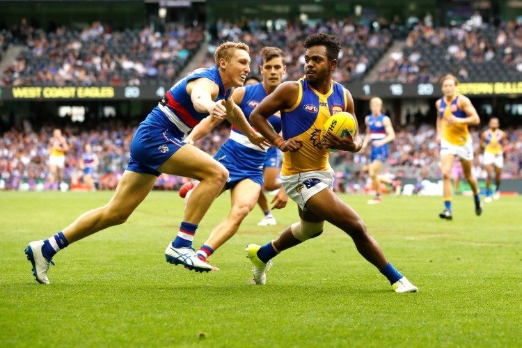 WILLIE RIOLI of the Eagles evades Bailey Dale of the Bulldogs during the 2018 AFL match between the Western Bulldogs and the West Coast Eagles at Etihad Stadium in Melbourne, Australia.