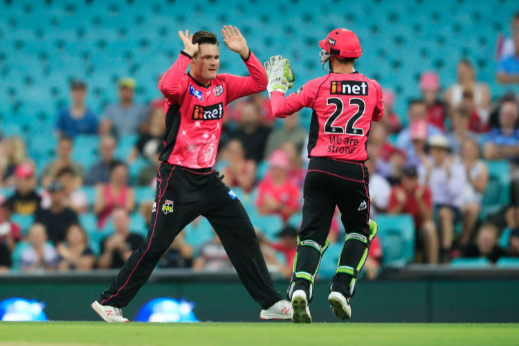BEN MANENTI of the Sixers celebrates a wicket during the BBL match between the Sydney Sixers and Hobart Hurricanes in Sydney, Australia.