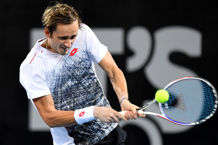 DANIIL MEDVEDEV of Russia plays a backhand in his match against Andy Murray of Great Britain during day four of the Brisbane International at Pat Rafter Arena in Brisbane, Australia.
