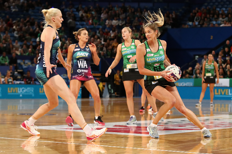 Super Netball players in action.