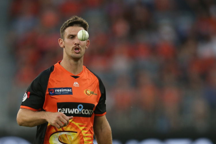 MITCHELL MARSH of the Scorchers walk back to his bowling mark during the Big Bash League match between the Perth Scorchers and the Melbourne Renegades at Optus Stadium in Perth, Australia.