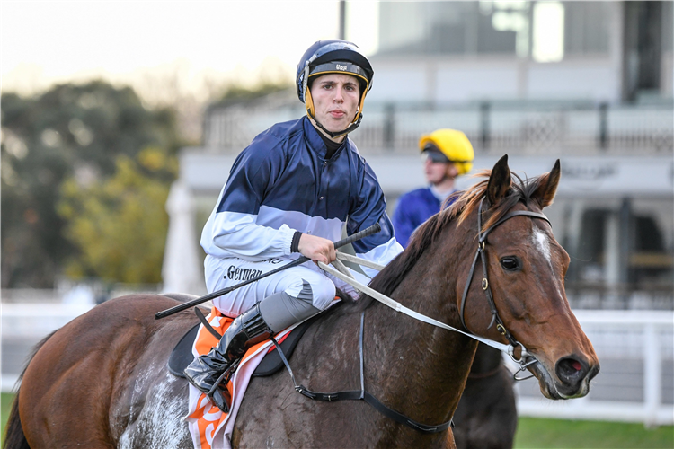 Talented ex-pat Kiwi apprentice Lewis German aboard Heptagon after their victory at Caulfield