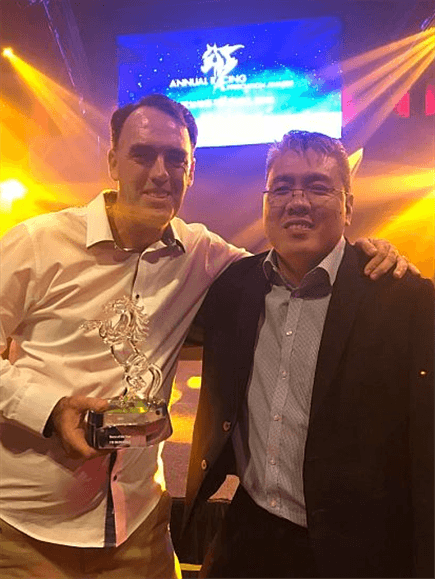 Trainer Shane Baertschiger and owner Desmond Ong of Doha Stable celebrate I'm Incredible's Singapore Horse Of The Year award.