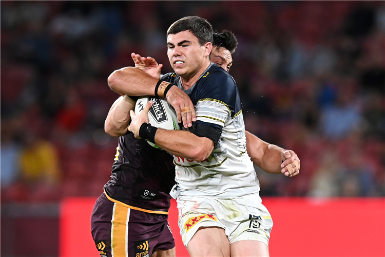 JAKE CLIFFORD of the Cowboys is tackled during the round 20 NRL match between the Brisbane Broncos and the North Queensland Cowboys at Suncorp Stadium in Brisbane, Australia