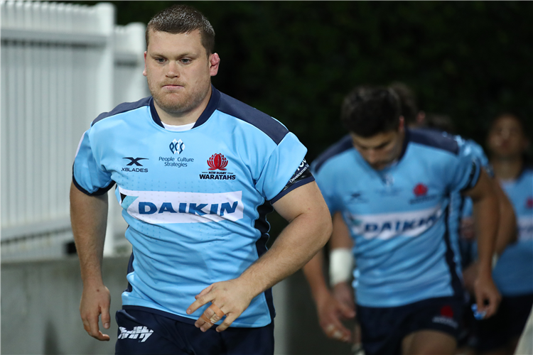 TOM ROBERTSON of the Waratahs runs out onto the field during the Super Rugby AU match between the Waratahs and the Reds at Sydney Cricket Ground in Sydney, Australia.