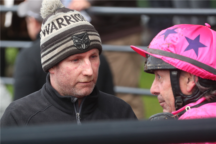 Trainer Jamie Bullard (left) speaks with Chris Johnson after the win by Yannick