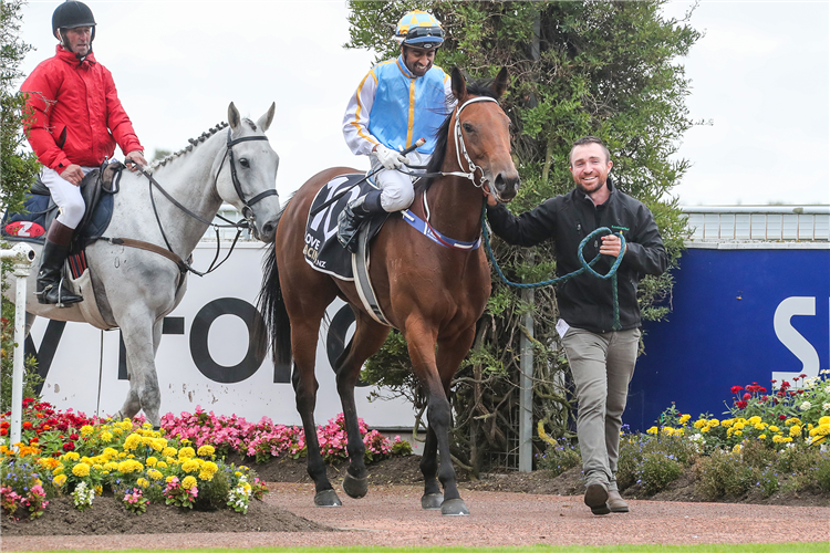 Trainer Robert Dennis leads Out Of The Park and Krishna Mudhoo back to the winner's enclosure at Riccarton