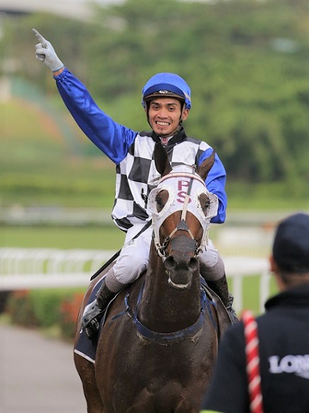 Shafiq Rizuan celebrates his career highlight, the 2015 Group 1 Longines Singapore Gold Cup win with the Patrick Shaw-trained Cooptado.