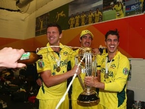 JOSH HAZLEWOOD, MITCHELL STARC and PAT CUMMINS of Australia pose with the trophy during the 2015 ICC Cricket World Cup at Melbourne in Australia.