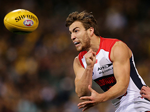 Jack Viney of the AFL Demons handpasses the ball during a round 14 AFL match against the West Coast in Perth Australia