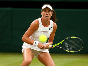 Johanna Konta of Great Britain in action during a ladies' singles quarterfinal match against Simona Halep of Romania at Wimbledon