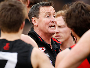 John Worsfold senior coach of the AFL Bombers addresses his players during a round 16 match against the Collingwood Magpies