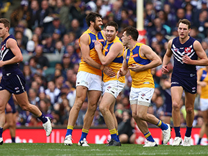 Eagles' players celebrate a goal during their AFL round 17 match against the Dockers at the Domain Stadium, Perth