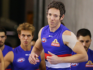 Rob Murphy of the Western Bulldogs leads the team out during the round 13 AFL clash with the Saints