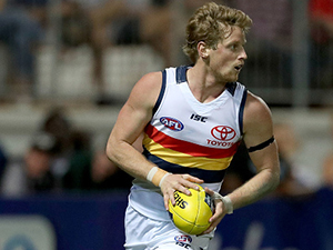 Rory Sloane of the AFL Crows runs the ball during their round 15 clash with the Demons at the TIO stadium in Darwin