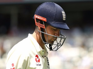 ALASTAIR COOK of England looks dejected after being dismissed by Mitchell Starc of Australia in the First Test at The Gabba in Brisbane, Australia.
