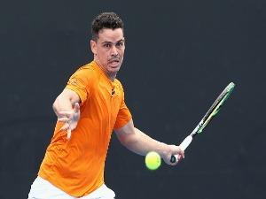 ALEX BOLT of Australia competes against Bernard Nkomba of Australia in the Australian Open match at Melbourne Park in Australia.