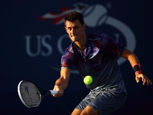 BERNARD TOMIC of Australia returns a shot during a match of the 2017 US Open at the USTA Billie Jean King National Tennis Center in New York City