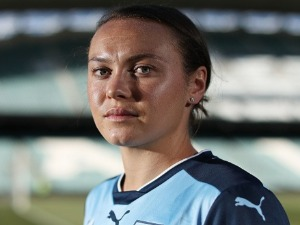 CAITLIN FOORD poses after re-signing with Sydney FC at Allianz Stadium in Australia.
