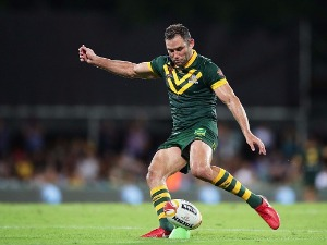 CAMERON SMITH of Australia kicks during a 2017 Rugby League World Cup match at AAMI Park in Melbourne, Australia.