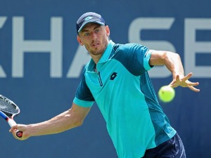 JOHN MILLMAN of Australia returns a shot in a Men's Singles match of the 2017 US Open at the USTA Billie Jean King National Tennis Center, in New York City.