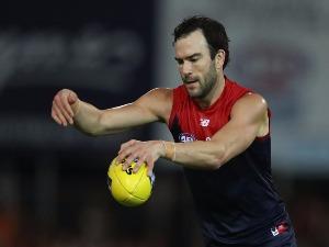 JORDAN LEWIS controls the ball during an AFL match at TIO Stadium in Darwin, Australia.