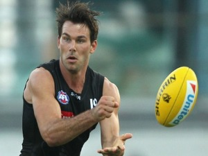 LEVI GREENWOOD handballs during the Collingwood Magpies AFL Intra-Club match at Olympic Park in Melbourne, Australia.
