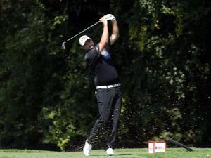 MARC LEISHMAN of Australia plays his shot at East Lake Golf Club in Atlanta, Georgia.