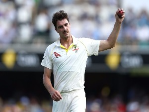 PAT CUMMINS of Australia prepares to bowl during the First Test Match of the 2017/18 Ashes Series at The Gabba in Brisbane, Australia