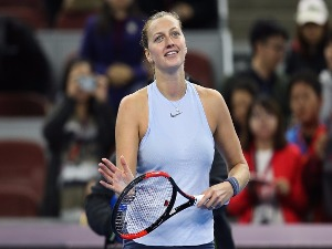 PETRA KVITOVA celebrates after winning the Women's singles match at the China National Tennis Centre in Beijing, China.