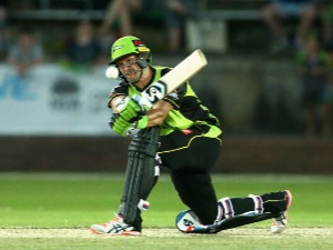 SHANE WATSON of the Sydney Thunder plays a shot during the Big Bash League exhibition match at Lavington Sports Ground in Albury, Australia.