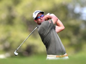 ADAM SCOTT of Australia plays a shot during the Australian PGA Championship at Royal Pines Resort in Gold Coast, Australia.  Photo by Bradley Kanaris/Getty Images