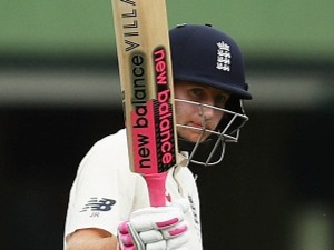 JOE ROOT of England acknowledges the crowd after scoring a half century during the Fifth Test match in the 2017/18 Ashes Series at SCG in Australia.