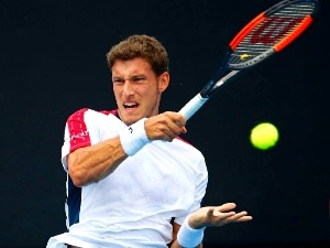 PABLO CARRENO BUSTA of Spain plays a forehand against Jason Kubler of Australia of the 2018 Australian Open at Melbourne Park in Australia.