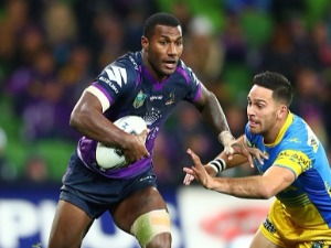 SULIASI VUNIVALU of the Storm runs with the ball during the round 18 NRL match between the Melbourne Storm and the Parramatta Eels Mel