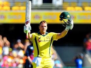 AARON FINCH of Australia celebrates scoring a century during game two of the One Day International series between Australia and England at The Gabba in Australia.